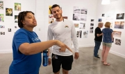 Curator Roxanne R. Campbell with painter Joshua Carter