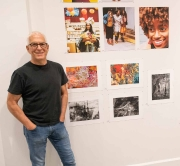 Photographer Jeffrey Rubin with his work beside him, lower right
