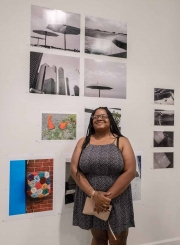 Photographer Tifannee Gladney with her four images above her